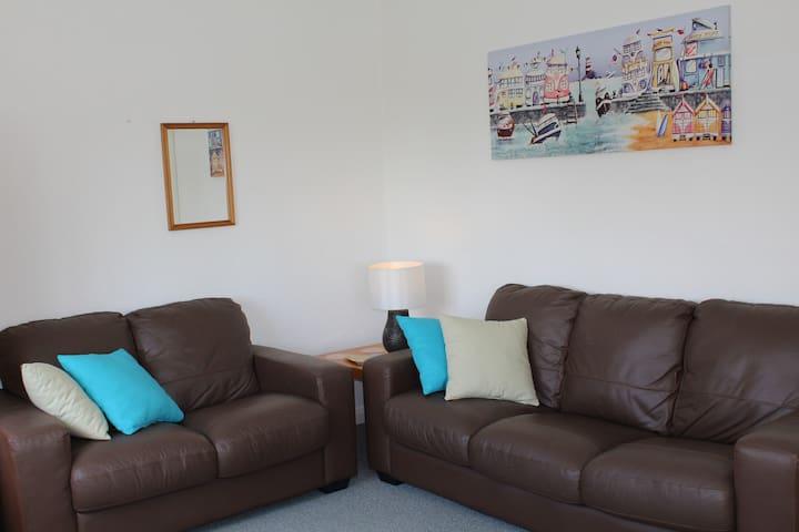 Plenty of seating on leather sofas