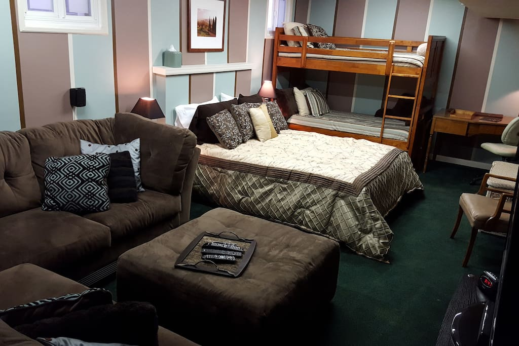 large suite with 3 beds, wrap-around couch and desk