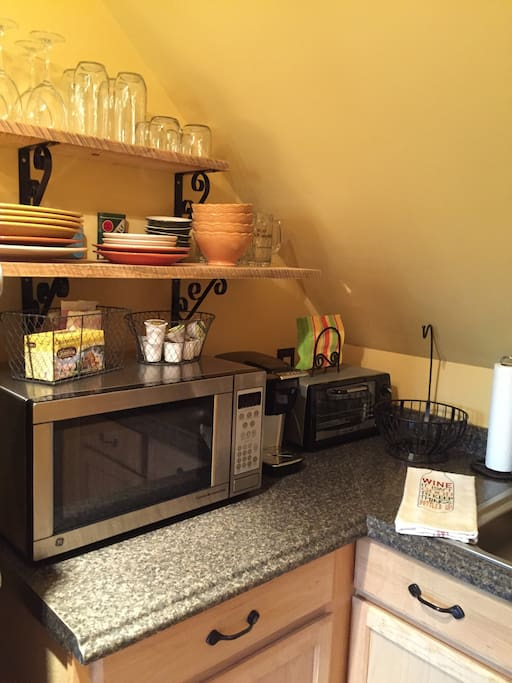 Kitchenette with fridge, microwave, Keurig coffee machine, and toaster oven.