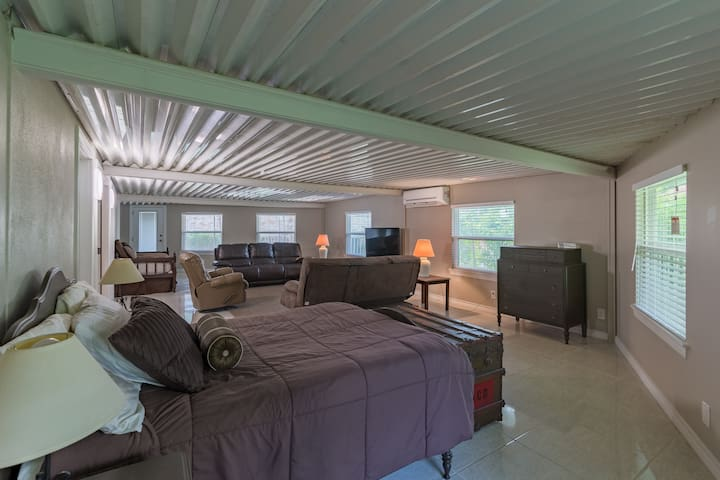 Large back recreational room takes up the whole length of the villa.  This space has a designated family room space  with couches and tv,  as well as three sleeping areas.  There is a full bed, full futon, and a twin bed. It also has a  1/2 bath.
