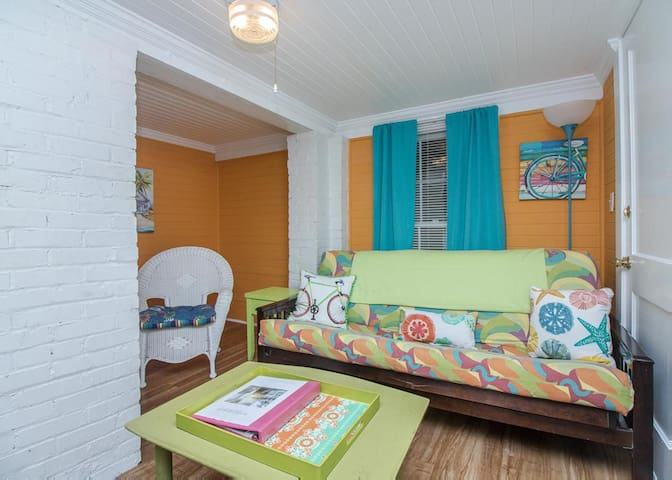 Cheerful living room with futon for additional sleeping