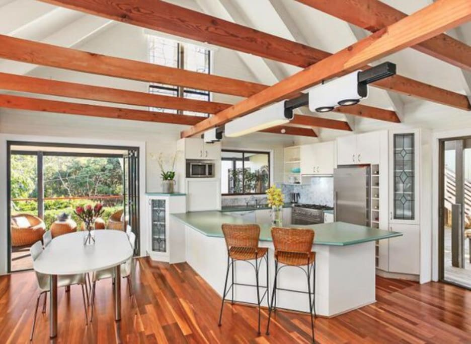 Open plan kitchen and dining, leading out to our gorgeous wrap around veranda
