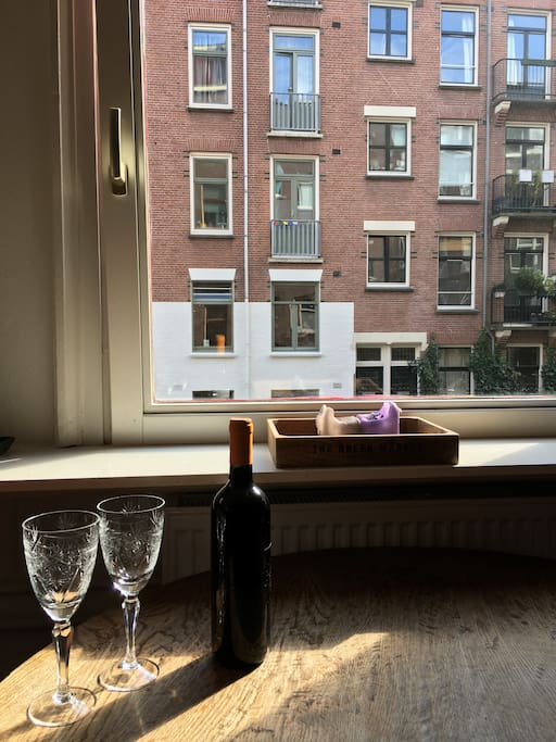 Enjoy a glass of wine and a typical Amsterdam view