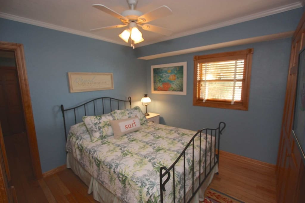 Let the Kids or Guests Wind Down after a Fun Filled Beach Day in this Lovely Guest Bedroom Queen Bed, Flat Screen Cable TV