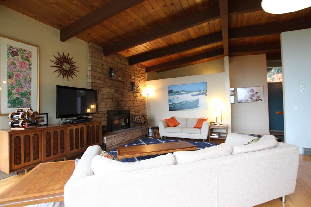 Large living room with comfy couches, large TV with Netflix and DVD's, wood burning fireplace.