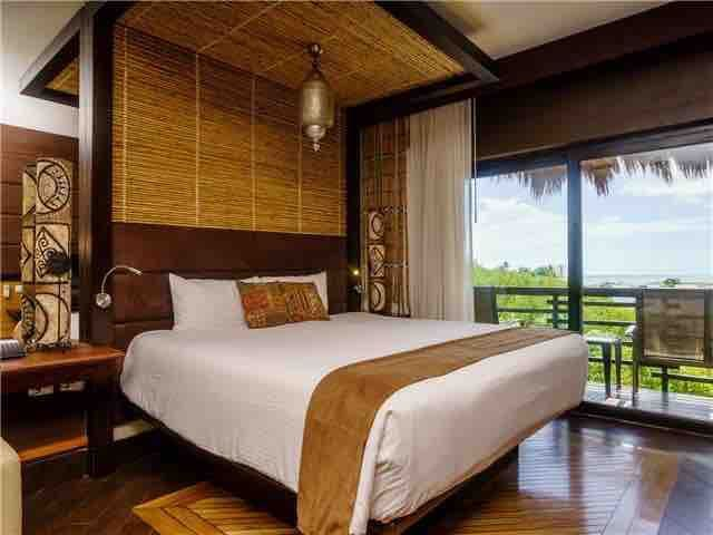 Ocean views await you from this king size bed.