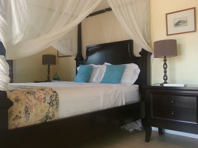 Second room with four poster queen size bed