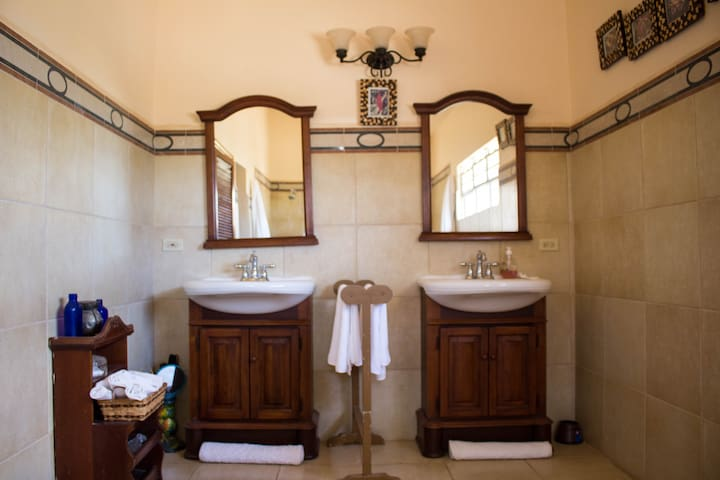 Downstairs King bathroom with His and Her facebasins