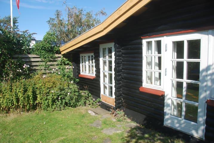 Hyggeligt bjælkehus med havudsigt - Assens