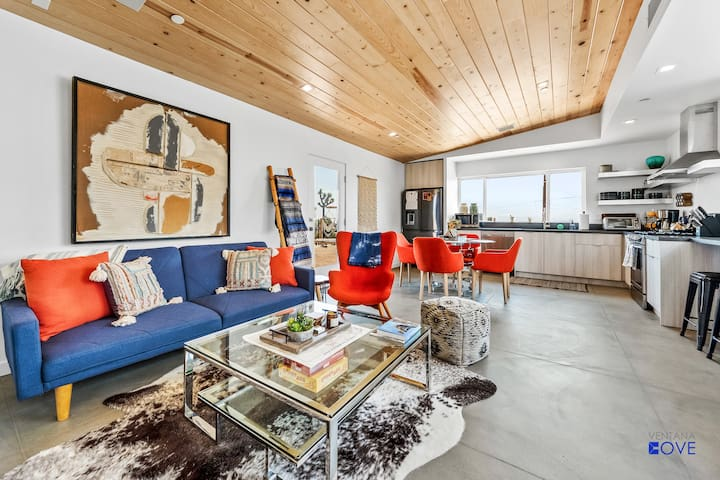 Spacious living room + kitchen with mountain views.