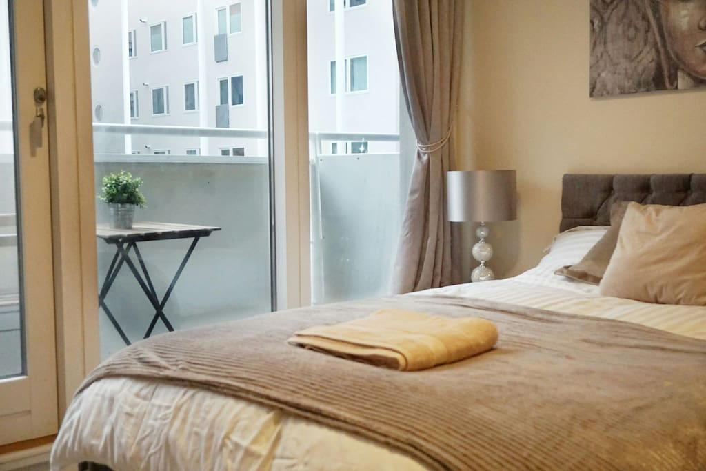 En-suite bedroom with balcony overlooking our beautiful courtyard.
