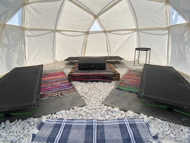 The Agave Abode comes with three Magellan Ultracompact Cots. They are stable with 5 legs and don't have any poles going across the fabric, giving you a comfortable nights sleep.