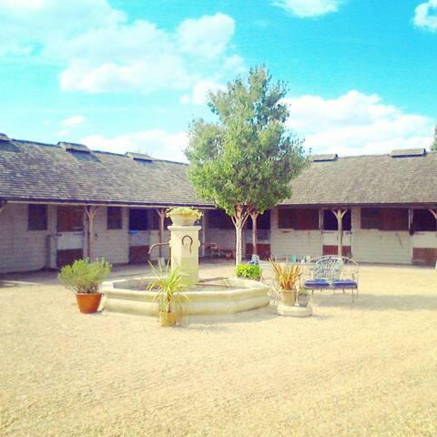 Coach house at high summer polo
