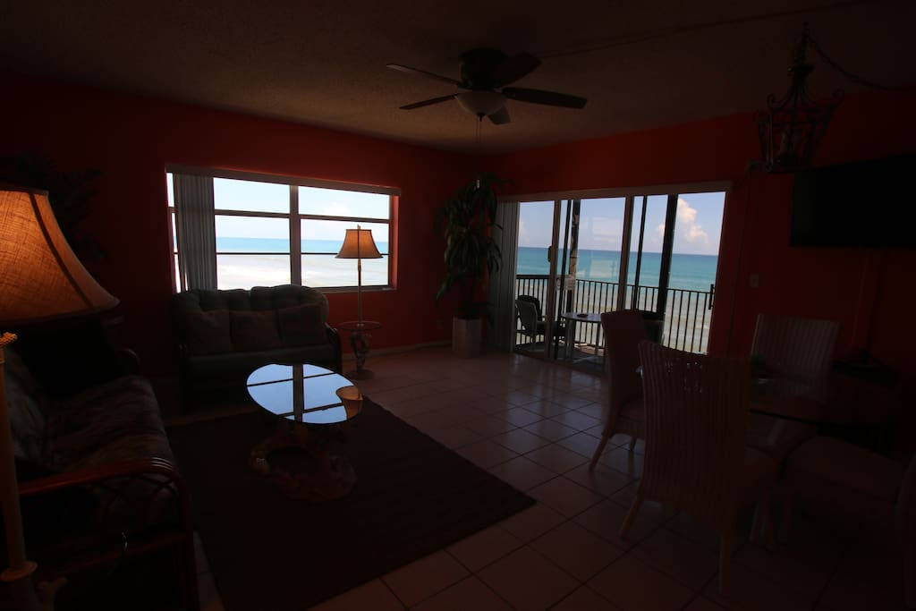 Living room has direct views of beach on two sides