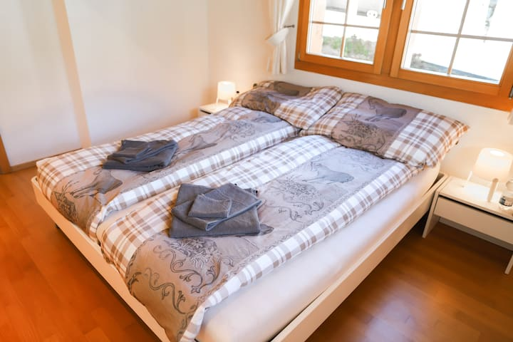 The to separate mattresses are very comfortable and with a total bed size of 1.80 x 2.00 meters, the bed should be big enough for most of the people.  We provide for all our guests three different sizes of towels.