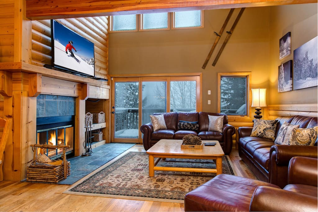 Large windows let in lots of natural light in the living room, where you'll find seating for 7.