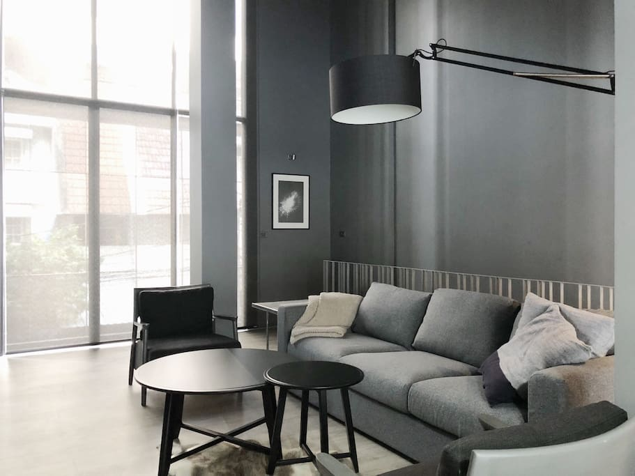 Functional for urban comfort living and luxuriously styled through out in monochromatic shades of cool & warm grey.