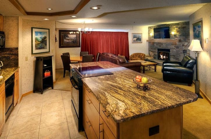 The spacious living area includes an updated open concept kitchen.