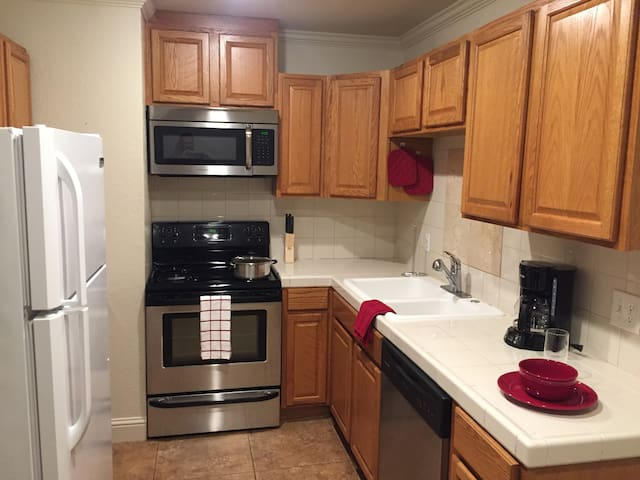 Fully stocked Kitchen with all the pots and pans you will need to cook during your stay. We also provide breakfast items that will be stocked in the kitchen cabinets. We have a coffee pot and toaster.