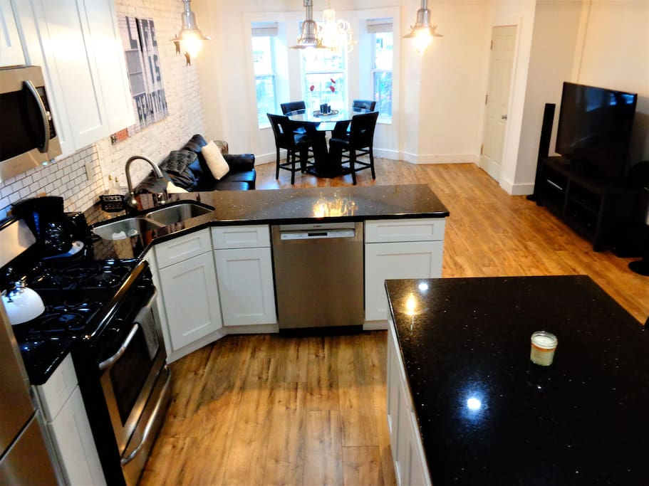 Upper Duplex has open kitchen, dining and living area layout.