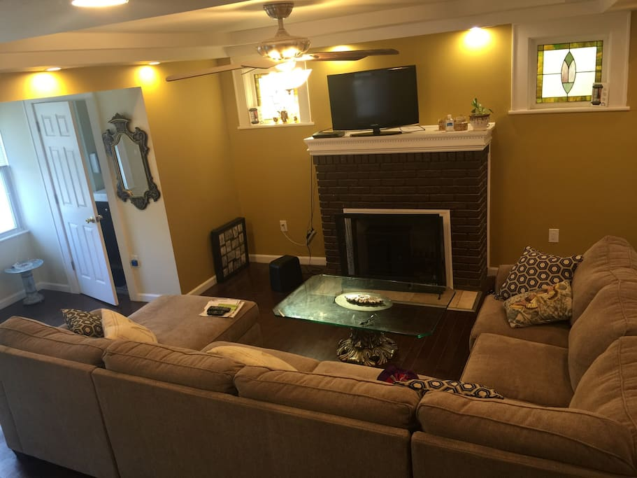 A large living room with an entertaining new large size sofa with chaise available. New hardwood floors!