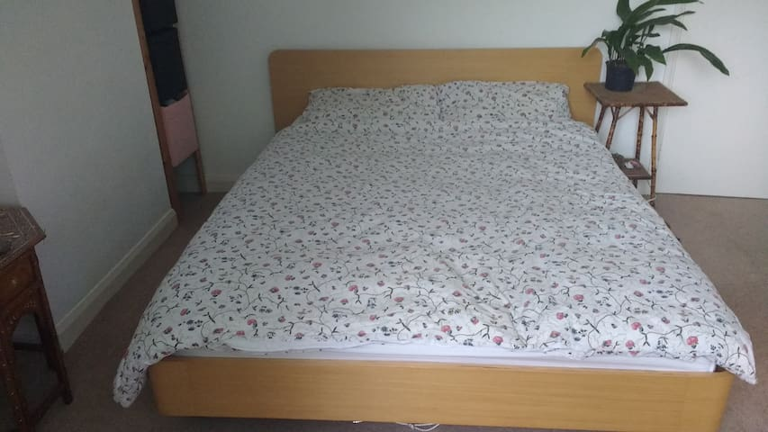 Double room close to town centre and bar walls.
