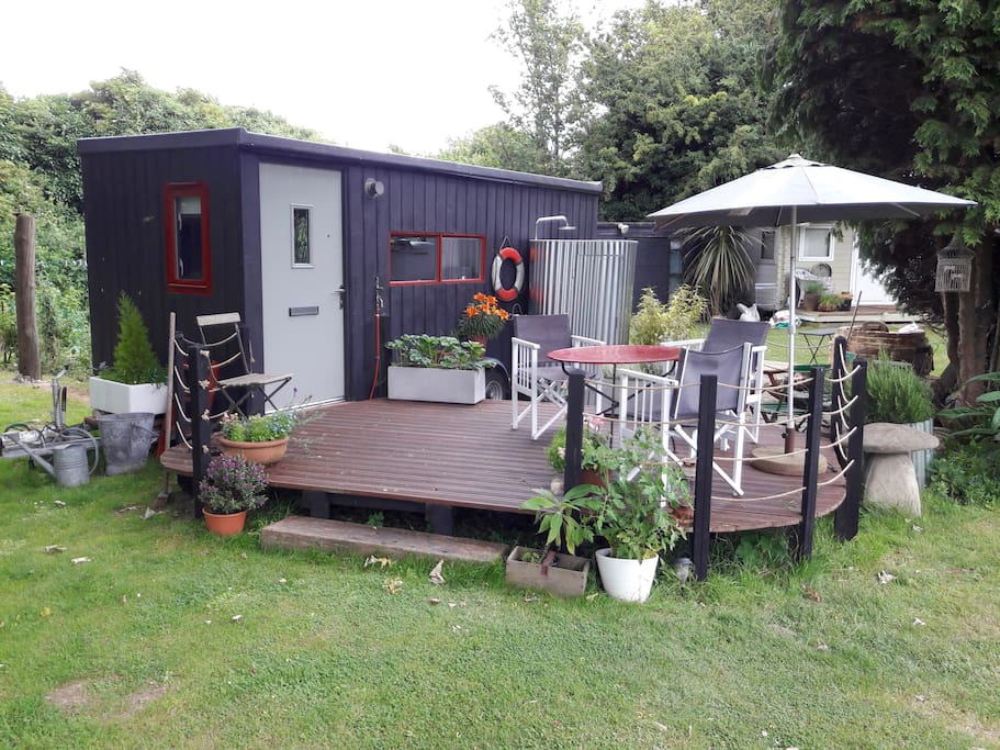 Tiny house with deck and private garden area