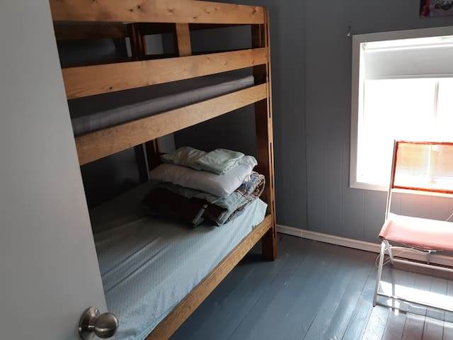 3rd bedroom with bunk bed and a third bed for small children. sleeps three. No AC in the summer in this room, but the other rooms will cool the entire floor with doors open. Pic 1