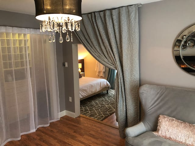 The curtain can be dropped to create two private spaces.  We can set up an extra king-sized inflatable bed or portable crib.