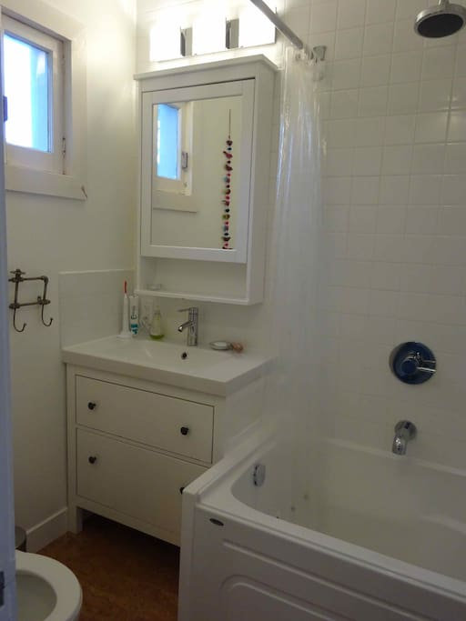 Updated bathroom with deep tub and rain shower