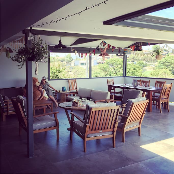 This is our deck. It is an amazing space to eat and relax. The deck is located upstairs and you walk out onto it from the dining area. There are stairs that go from the deck to our yard.