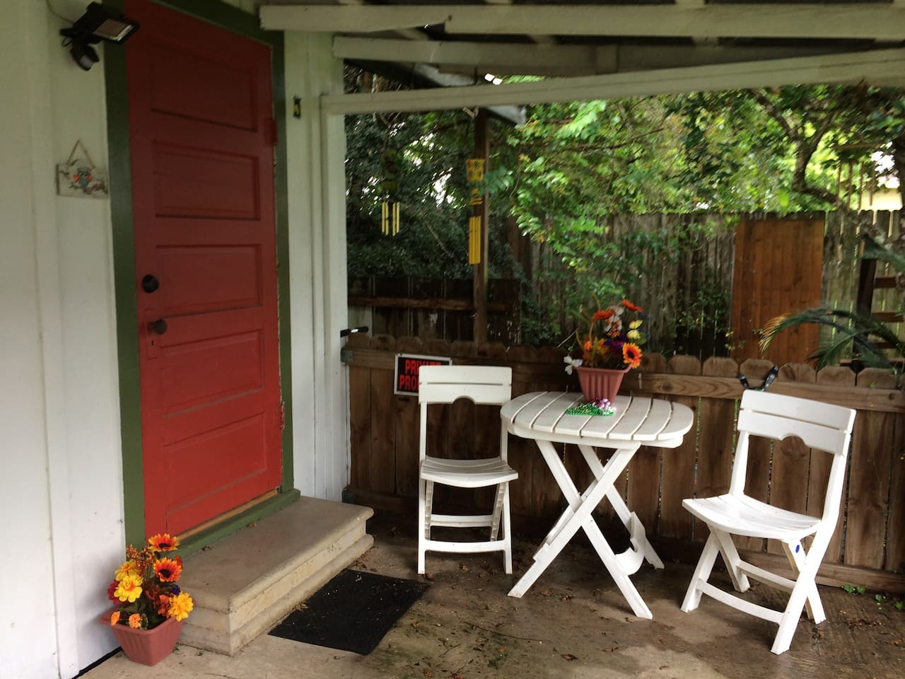 Studio outside relaxation  area. There's also another covered porch, behind to left with wooden swing for more relaxation!