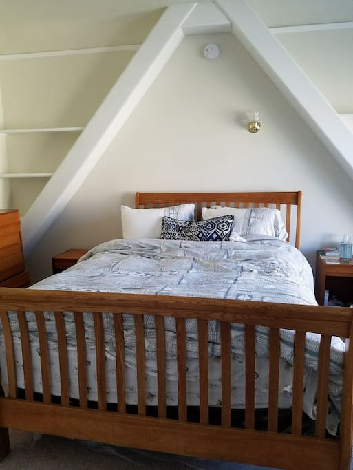 The bedroom is equipped with plenty of light, space and a comfortable queen sized bed