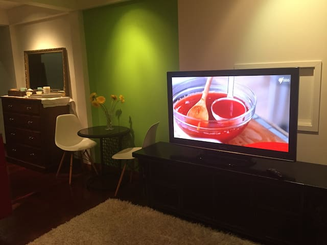 Lovely lounge area with large tv and foxtel