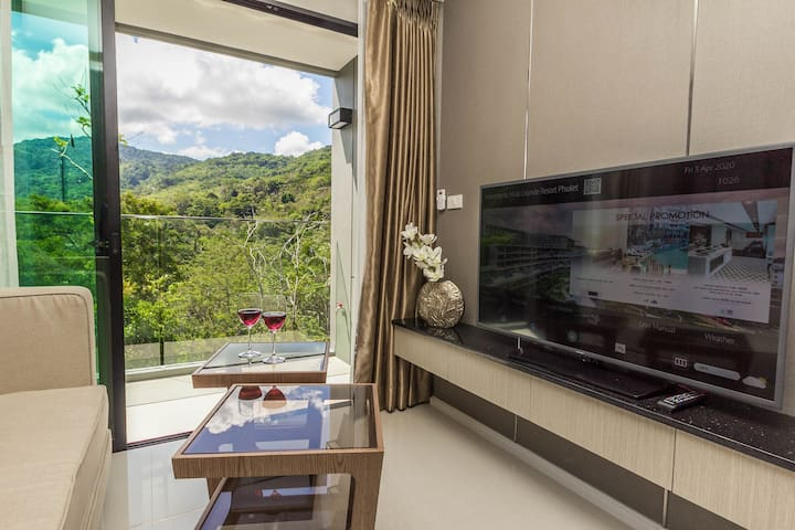 Breathtaking view to the mountains from the sitting area at the living room at brand new 2020 1 bedroom apartment walking distance to Surin beach and to Bang tao beach Phuket