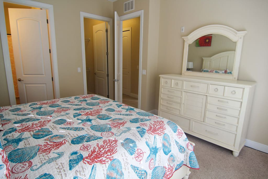 The master bedroom has plenty of dresser space as well as plenty of space in its walk-in closet.