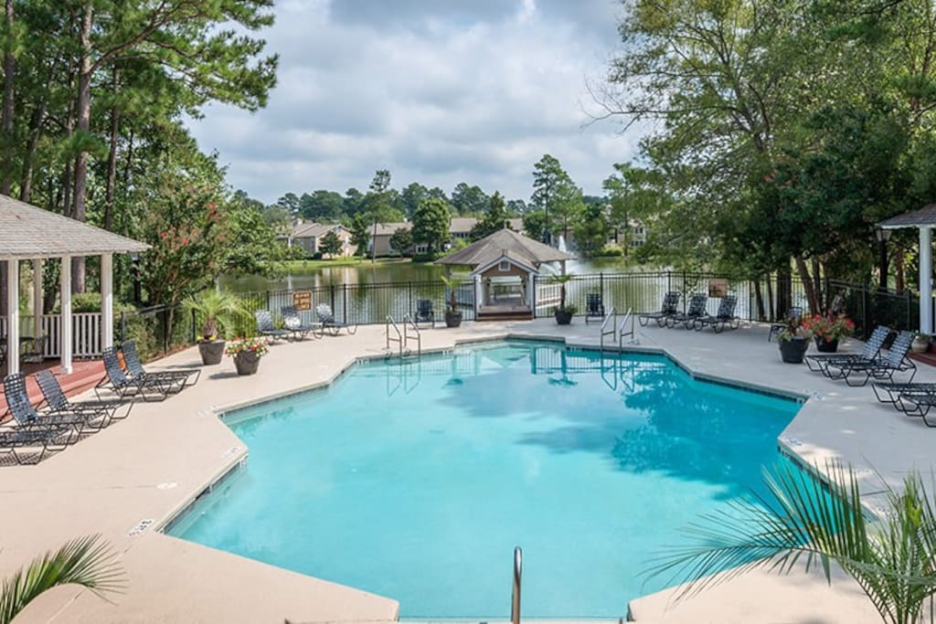 Beautiful swimming pool. Sit pool side in a lounge chair or BBQ on the gas or charcoal grills. The lake is near the pool.  ** Open All Year **