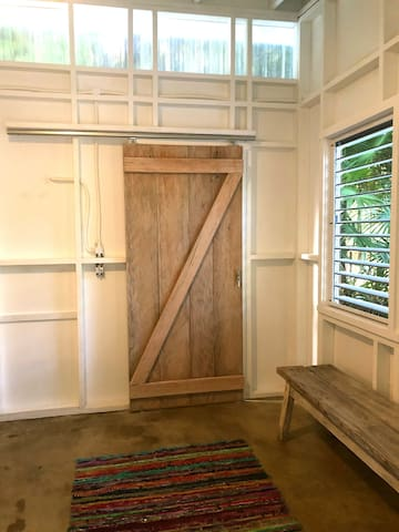 Every one loves a barn door.  Yours opens to your spa shower.