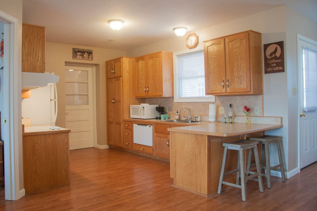 Apartment kitchen complete with stove top, microwave, dishwasher and refrigerator.  All is handicap friendly!