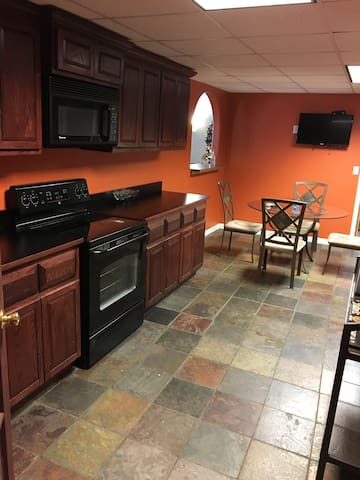 Full Kitchen with Electric Stove and appliances.