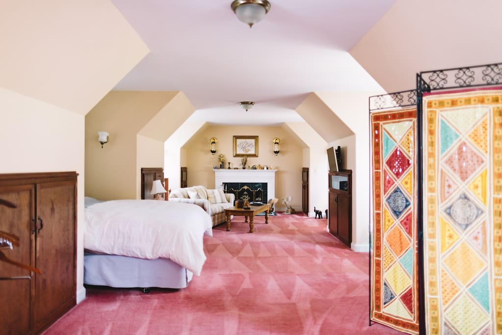 """Two flights of stairs lead to your spacious """"upstairs loft"""". Aside from the reg. queen size bed, this room could accommodate up to two additional queen-size Aero-beds for additional guests"""