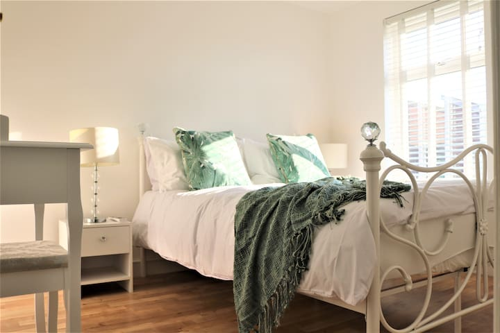 Pearl white bedroom with free parking