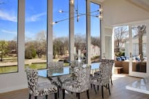 Dinning area with Lake View and access to patio and down to lake and dock.