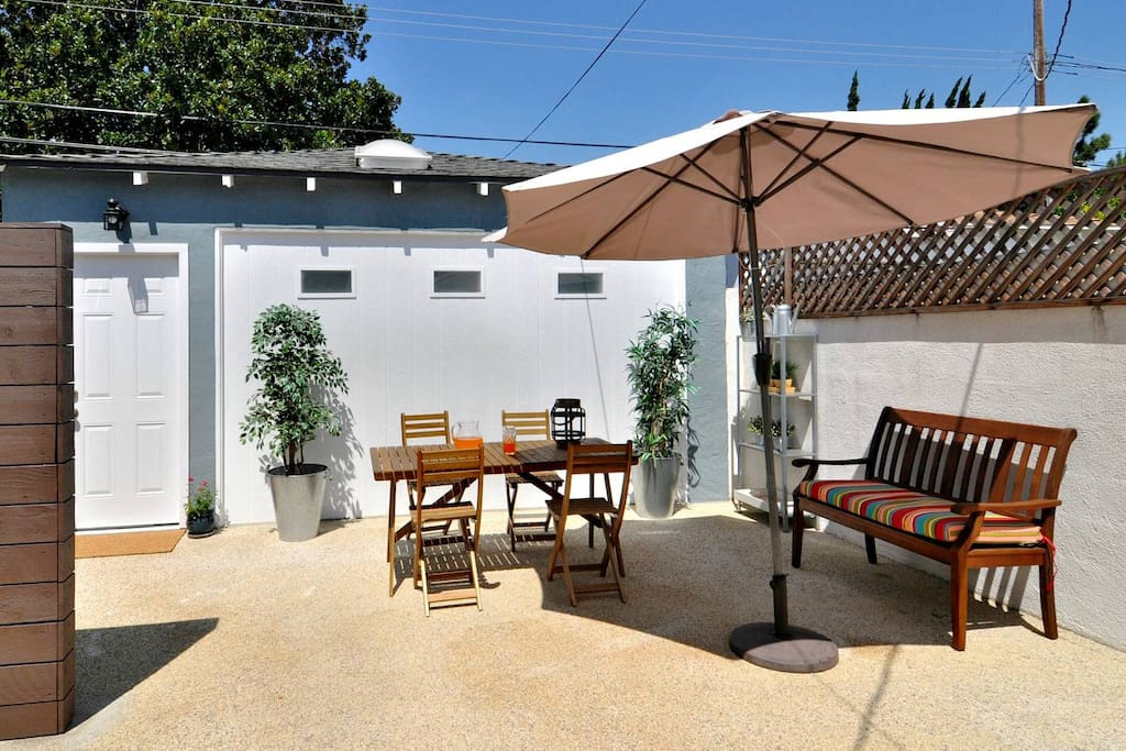 Your own outdoor space : large private patio with dining table, seating area and umbrella.