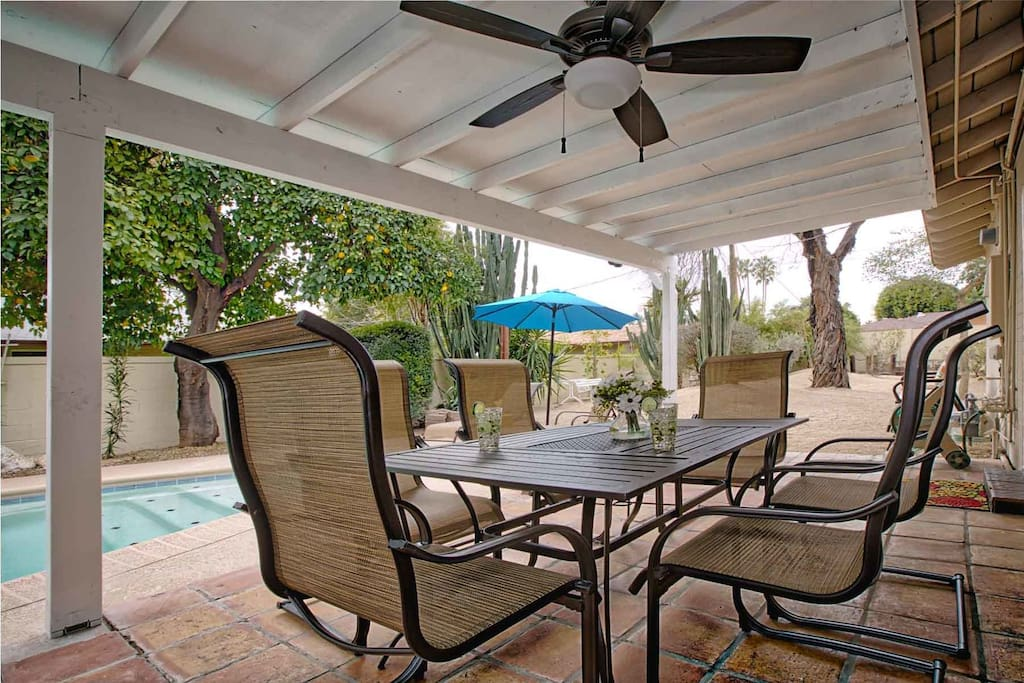 Covered patio with seating and outdoor fan