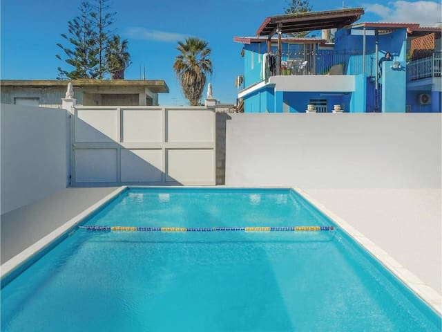 Blue apartment with shared pool