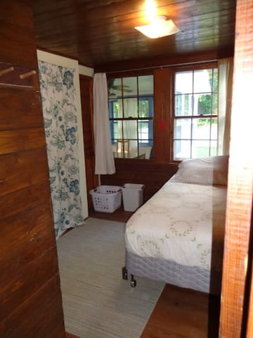 Utility room (housing washer/dryer and water heater) but also doubles as a third bedroom with a twin