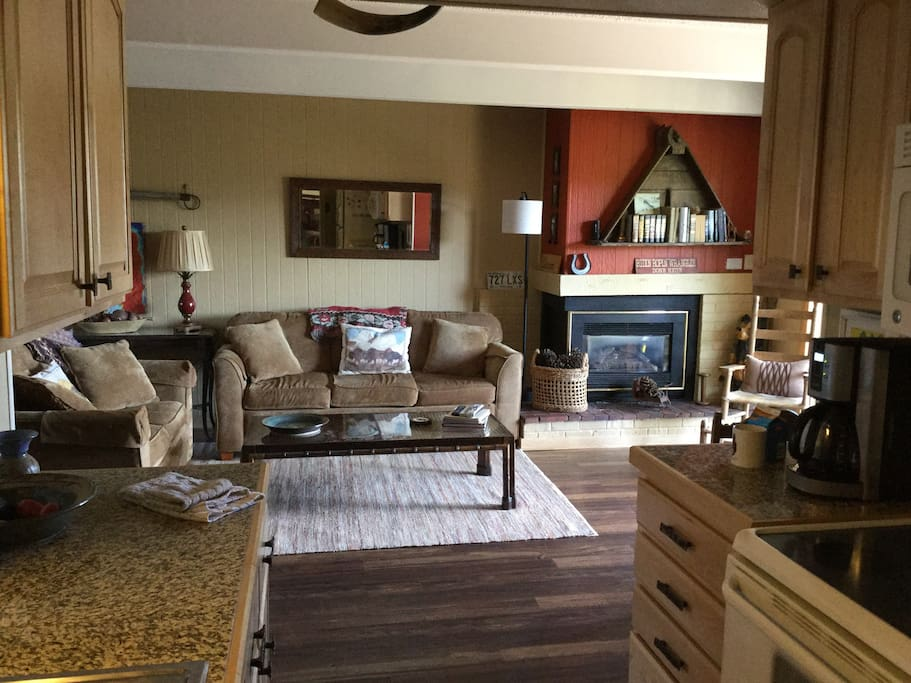 View of Living Room with Gas Fireplace From the Kitchen