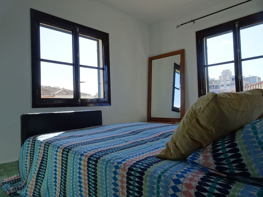 The two windows in the room makes a very luminous happy room.