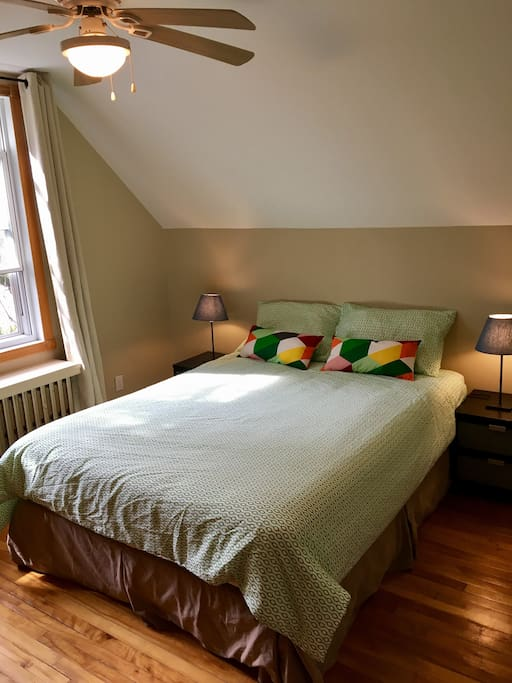 Very bright upstairs bedroom with queen bed